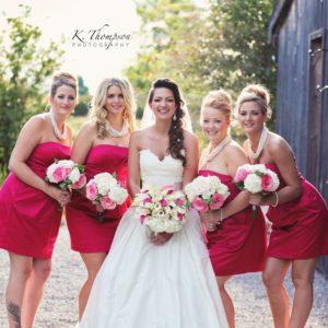 country-barn-wedding-ontario-bridesmaids-wedding-red-dresses-bridal-makeup-updo-hair